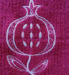 Dish Towel   Pomegranate Embroidered  in Fuschia Judaica--- the green hamsa hand and this pomegranate tea towel really show how deeply entwined Jewish culture and iconography is with the other cultures of the region-- I grew up thinking of the Hamsa hands as hands of Fatima.