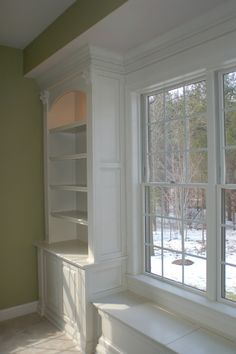 LOVE the custom built-in bookcases framing the window! Learn how to build your own custom bookcase at Remodelaholic.com -- http://www.remodelaholic.com/2013/05/built-in-bookshelves/