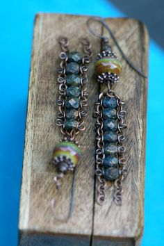 Antique copper chain (soldered links, resistant) has been ornate by me with textured, deep blue Czech glass in caterpillar design and dangles bellow