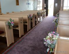 Zig-zagging the pew flowers to save cost while creating a beautiful aisle in the church