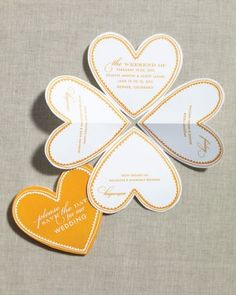 """""""Folded Heart Save-the-Date"""" . These cards unfold to reveal a weekend's worth of activities, which makes them ideal for weddings with multiple events."""