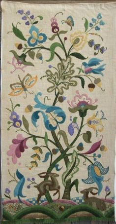 1932 Alaska Crewel Embroidery wall hanging with floral & animal work.