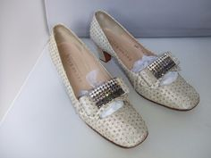 1960's Bruno Magli evening shoes metallic silver tissue, with rhinestone buckles.