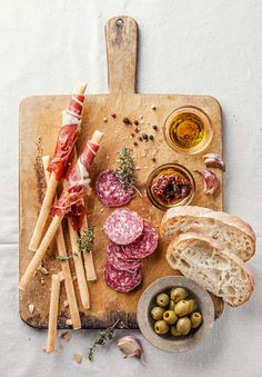 Bread sticks with ham and salami on wooden background #food #photography