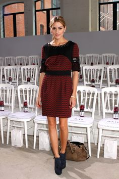 Olivia Palermo wearing a red and black Matthew Williamson embellished dress for the designer's spring/summer 2010 show at London Fashion Week