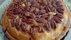 For this clever creation, butter and pecans are put into the pie pan before the bottom pastry. After the pie is completely filled with sweet, spiced apples, topped with a second crust and baked, the entire pie is flipped to reveal a luxurious pecan glaze.