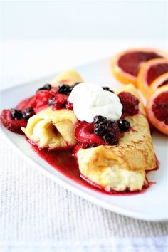 """Cheese Blintzes with Berry Sauce  """"Blintzes are like crepes on crack.  Still the same, super thin and sweet batter but encasing a sweet cheese filling. """""""