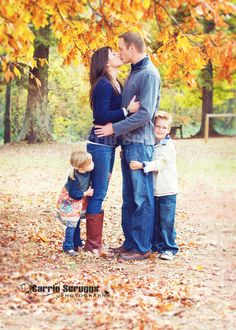Fun family pose - Carrie Scruggs PHotography....I like this one but i would have kennedy in the middle of us
