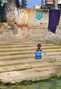 boy washing himself on ghat in India