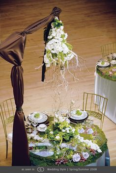 Garden-enclosed tabletop with matching chandelier, set on platinum linen. @grace_ormonde @wedding_style