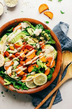 A simple yet flavorful and satisfying salad with organic greens, roasted sweet potato, creamy avocado, and a lemon-maple tahini dressing.