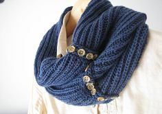 navy blue infinity scarf with buttons...love this! This is on Etsy, but I need to find a pattern like it.