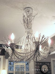 A white twig chandelier created from grapevines and willow branches - via Funky Junk Interiors