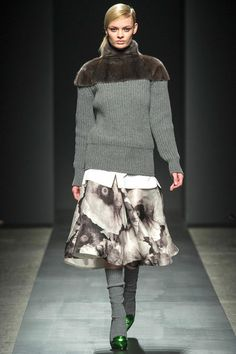 Combos and silhouette.....the caplet, sweater proportion, print full skirt...baggy socks, and green shoes!