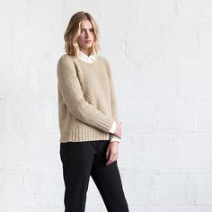 We want to wear this richly textured mock cable pullover everywhere. Knit in Woolfolk's chainette worsted weight, Julie Hoover's Kogle is a lofty sweater with an elegant rounded neckline, perfect for keeping warm on rainy winter days.