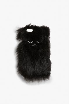 A fluffy phone case with Ikmo's signature pouty face on there.