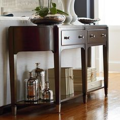 Cosmopolitan Hall Console Table by Bassett Furniture. Signature pieces feature glamorous curves and clean sophisticated lines to give a modern flair.
