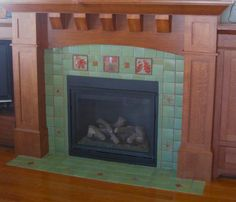 "Tiled fireplace using 6"" deco tile,and 4"" green field tile. Beautiful wood mantle!"