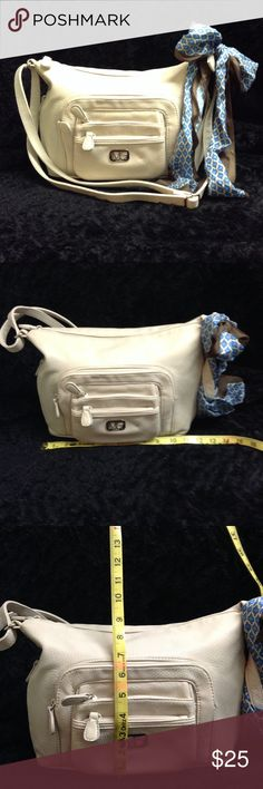 Multi Sac cream colored purse hand bag NWOT Multi Sac cream colored purse hand bag NWOT. Never used but does have some light discolored spots on the bottom. See picture. Comes with a blue and brown scarf. I would call this purse a size large in my opinion. Multi Sac Bags Shoulder Bags