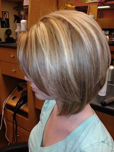 Blonde highlight on a strawberry brown base! Came out perfect on her bobbed cut!