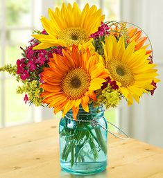 Warm Sunset Bouquet: orange and yellow sunflowers, pink dianthus, grass