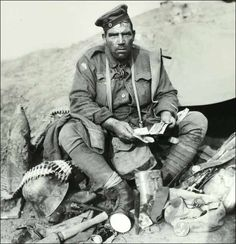 "Australian soldier Pvt Barney Hines after the battle of Polygon Wood shown with his collection of German souvenirs. He was known as the ""Souvenir King"" of WWI"