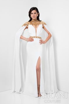 Stretch Crepe 'Caped' Floor Lengthmother of the bride dresswith Jewel Encrusted Neckline, Shoulders and Waist. This evening wear gown is the perfect dress for the big day and it comes in ivory gold, black black and black gold.