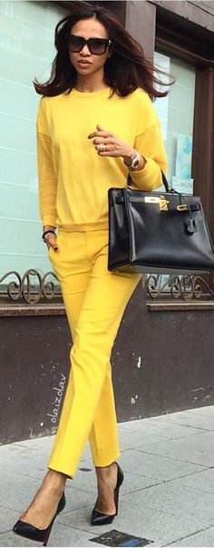 shift !... instead of black oufit and yellow shoes and bag ....have a yellow outfit & black shoes &bag