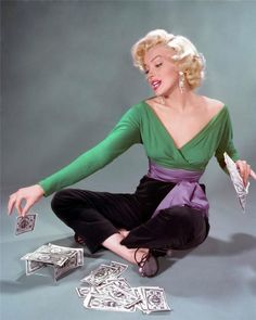 misspennydreadful:  Rare photo from the Gentlemen Prefer Blondes studio shoot… Marilyn playing with money by John Florea, 1953