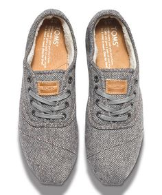 A cozy, casual shoe fit for a laid-back day. With the signature TOMS toe-stitch and suede insole cushioned with rubber, this wool shoe slips on and fits snug with hidden elastic straps. Laces optional! And with every pair you purchase, TOMS will give a pair of new shoes to a child in need. One for One.® Size note: TOMS run true to size. If you're typically in-between sizes, TOMS recommends ordering smaller since TOMS shoes will stretch with wear.