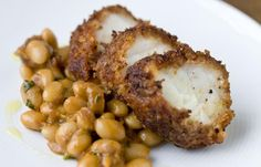 In this monkfish recipe, chorizo adds fantastic character to the monkfish tail. Spiced beans are served alongside the chorizo-crusted monkfish in this dish.
