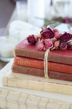 I could do this with a little baker's twine and some of my lovely old books:)