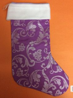 A personal favorite from my Etsy shop https://www.etsy.com/listing/252979842/handmade-christmas-stocking-purple-and