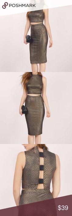 Two Piece Metallic Skirt and Crop Top Metallic skirt and crop top set by Tobi. Fitted and flattering. Brand new! Dresses Midi