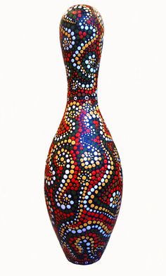 original art work by Kimberly Schlosser.  Acrylic paint was used to decorate an old bowling pin. Inspired by an Australian Aborigine painting technique.