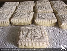 """Beautiful, perfectly made springerle cookies, showing off their lower """"foot"""" that forms during baking and is considered an essential part of the correctly made springerle."""