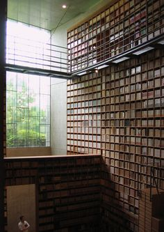The immense library by the immense cubic art window, library at the Shiba Ryōtarō Memorial Museum by Tadao Ando.