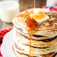 These Eggnog Ricotta Pancakes are fluffy and full of holiday flavor! Made with an eggnog and ricotta base, they make a fantastic holiday breakfast!
