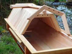 BackYardHive.com - Cathedral Gallery - A Cathedral Hive built by Valerie in France. She is ready to put the bees into the hive!