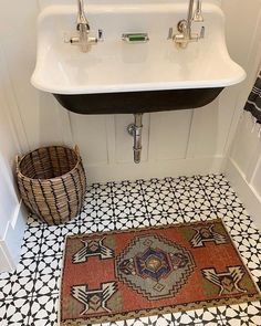 boho bathroom with cement tile Powder room with cement tile, vintage runner and mounted sink over board and batten paneling #poderroom #cementtile #vintagerunner #wallmountedsink #boardandbatten #BathroomAccessories