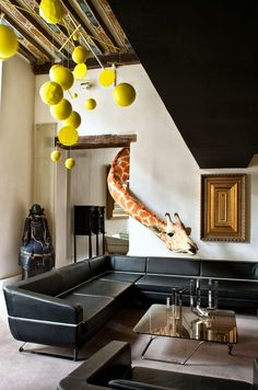 Imagine a Giraffe in your living room. . . . . . Ora Ito's eccentric apartment in Milan