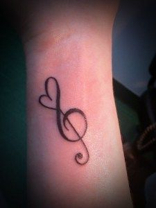Music tattoos are much more minimalist than others, which may be more elaborate, although some can be mixed with different images. Normally a tattoo of this type generally includes a musical note or sound effect.