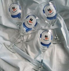 Snowman Wine Glasses Hand Painted.  I'd paint each one a little differently (scarf color, ear muffs, etc.) so people could easily tell which one is theirs.