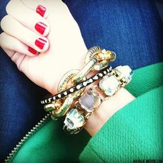 red nails + bracelets.