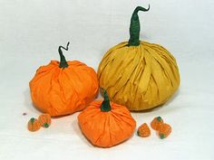 How to make these pumpkins filled with treats out of tissue paper.  An easier version is out of two egg cartons-put two holders together to make a pumpkin like shape and cover with tissue.  Don't forget treats inside!