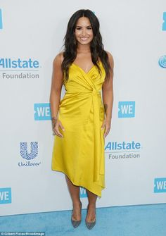 Put some sunshine in your evening wear with Demi's Victoria Beckham dress #DailyMail Click 'Visit' to buy now