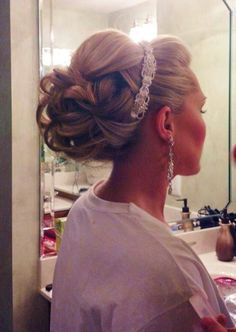 Bridal hair, wedding updo, with embellished head band and drop earrings.