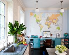 """Compromise with whatever element you feel is delightful and attractive to your children, but never go whole hog into a kid theme,"" says decorator Celerie Kemble, who encourages parents to bridge the aesthetic gap between child and adult. Among Kemble's go-tos for shared family spaces are maps, like the enlarged one in this kitchen. ""Maps are inherently beautiful, and they are mesmerizing to both children and grown-ups,"" Kemble says."