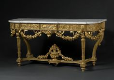 Carved Gilt Wood Louis XVI Style Console Table. Parisian work of the middle of the 19th century