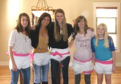 Toilet paper diaper game. Teams of two are timed, armed with tape and TP, and judged based on who has the best diaper!